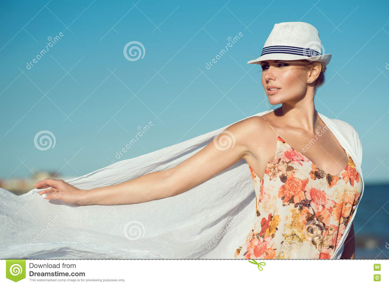Beautiful Blond Woman In Stylish Hat And Bright Top With Flowers