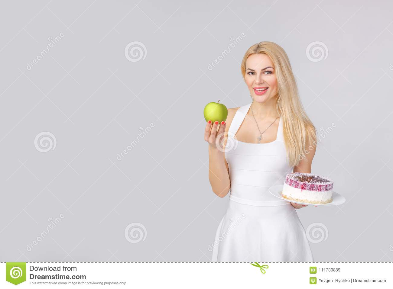 Woman chooses between cake and apple