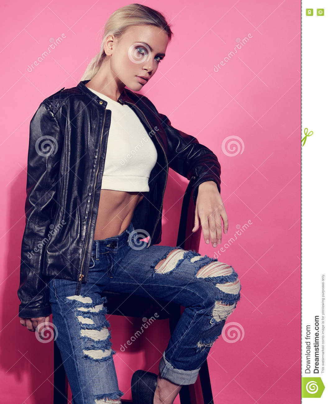 Beautiful Blond Young Model Posing In Black Leather Jacket