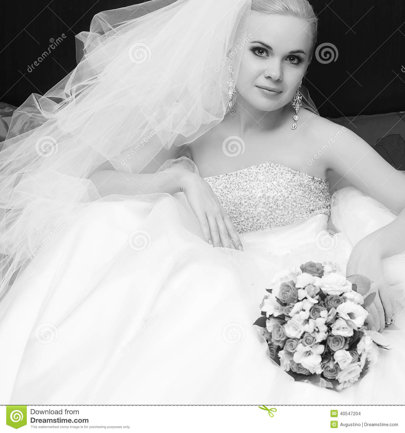 47 Stunning Wedding Hairstyles All Brides Will Love: Beautiful Blonde Bride With Great Vapory Veil Stock Photo