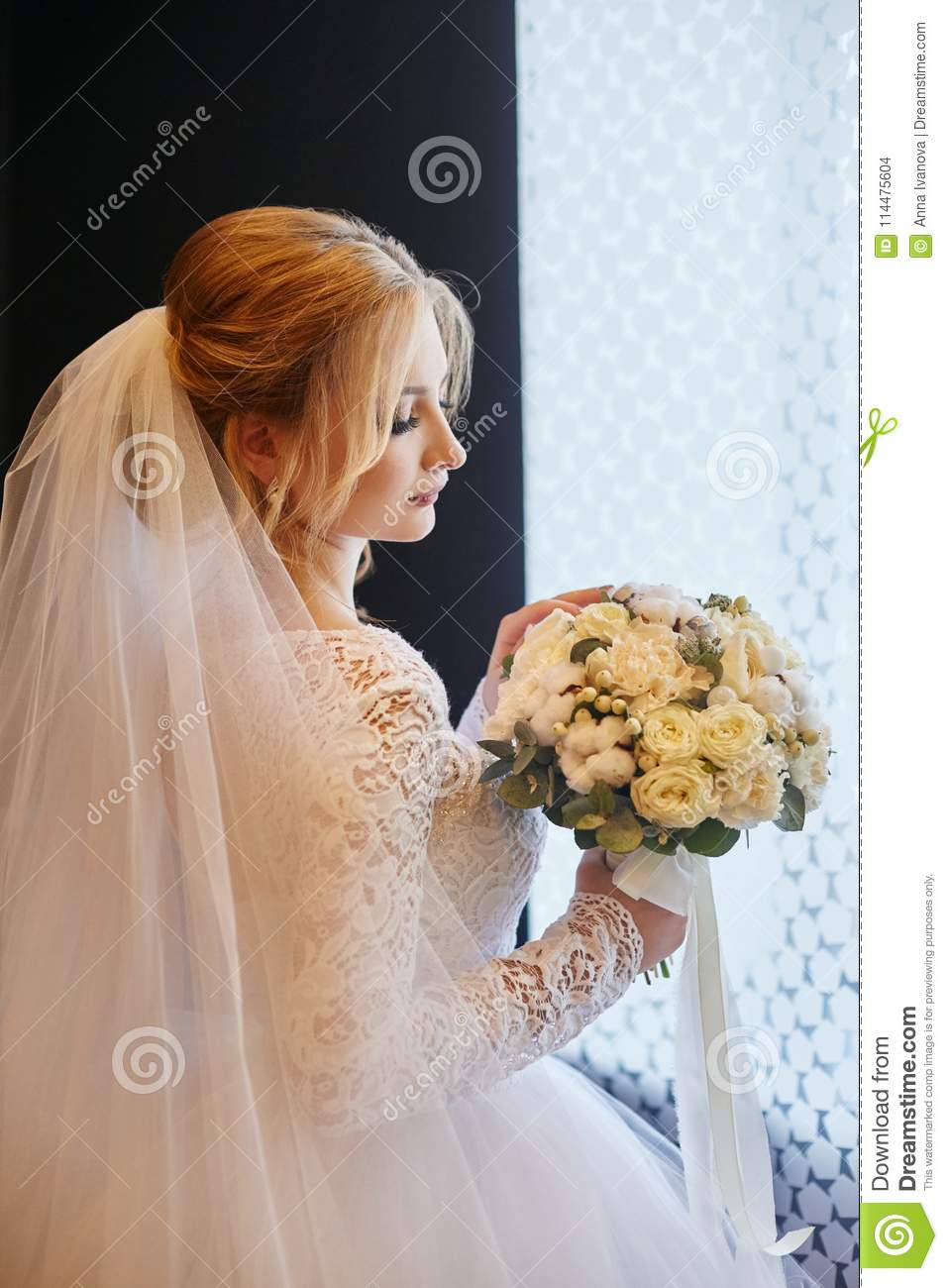 Beautiful Blonde Bride In The Morning In A White Wedding Dress W