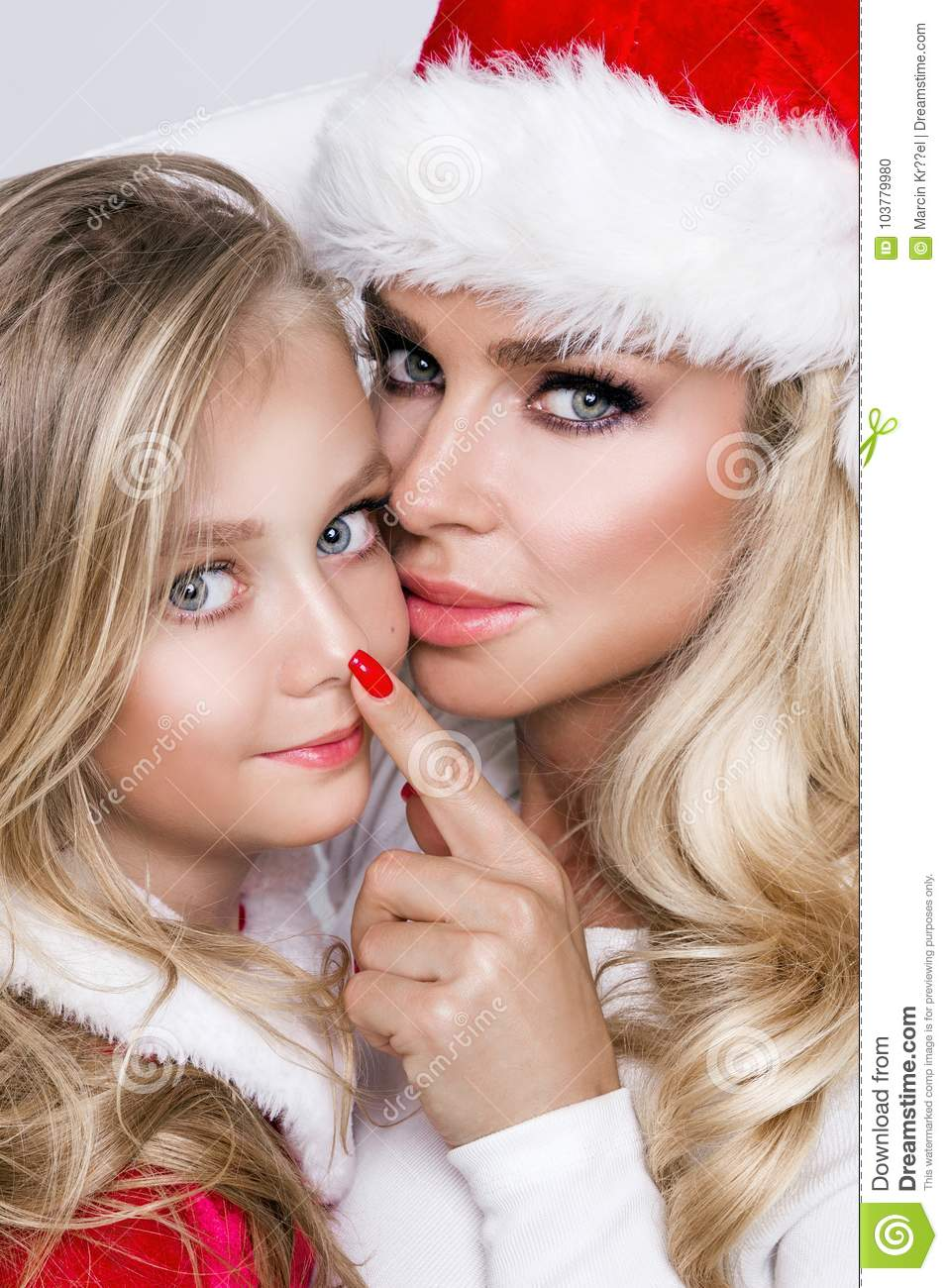 Beautiful Blonde Female Model Mother With Daughter Dressed In A Santa Claus Costume Christmas Mood And Love Of Mother