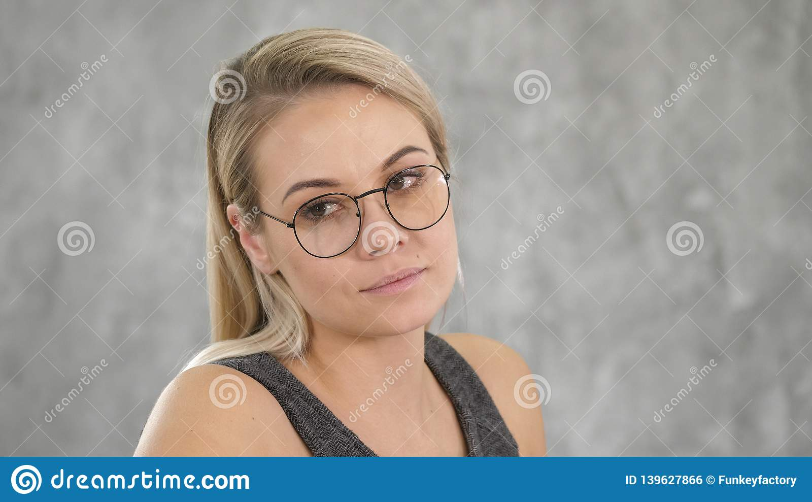 Beautiful blonde female with puzzled expression.
