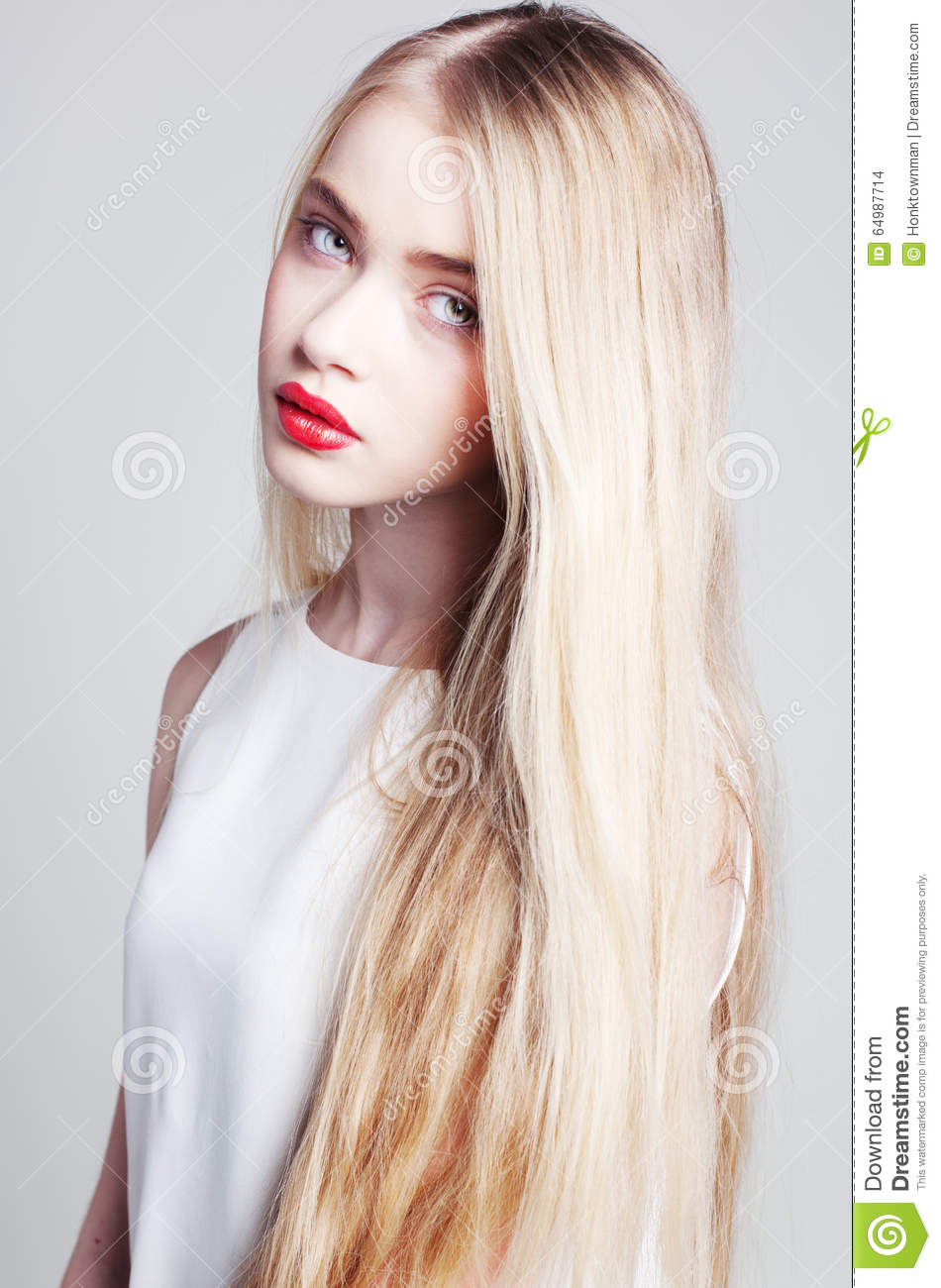 Beautiful Blonde Girl With Long Hair And Green Eyes Stock Photo