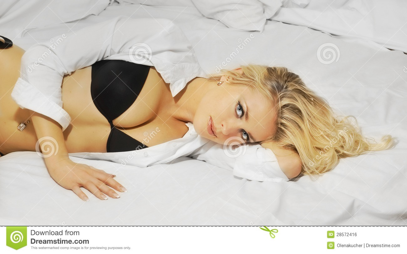 beautiful blonde girl is lying in bed royalty free stock image image 28572416. Black Bedroom Furniture Sets. Home Design Ideas