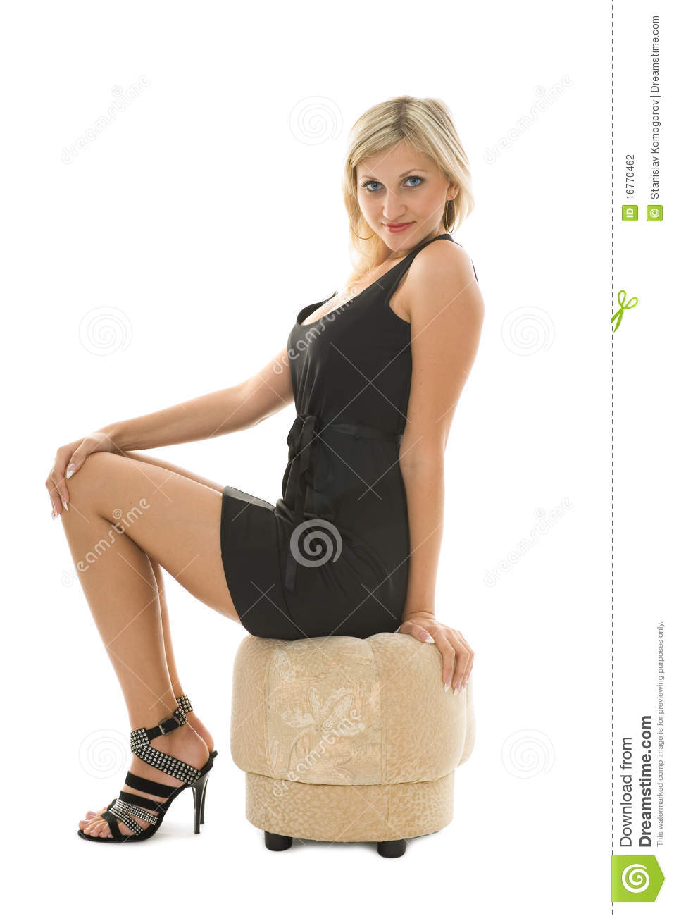 Beautiful blonde girl is sitting on an ottoman stock for Ottoman to sit on