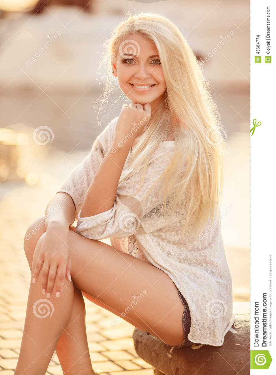 Beautiful blonde girl in the street of the city.