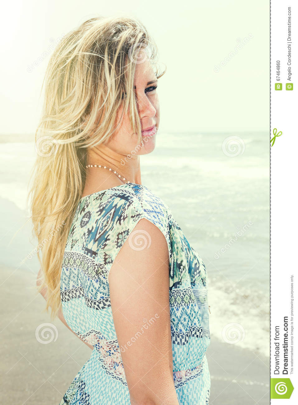 Beautiful blonde hair girl with sea background. Sweet attitude