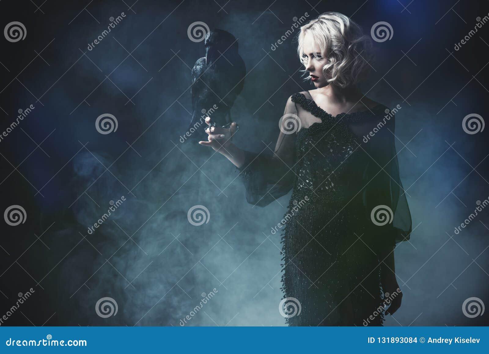 Holding black raven