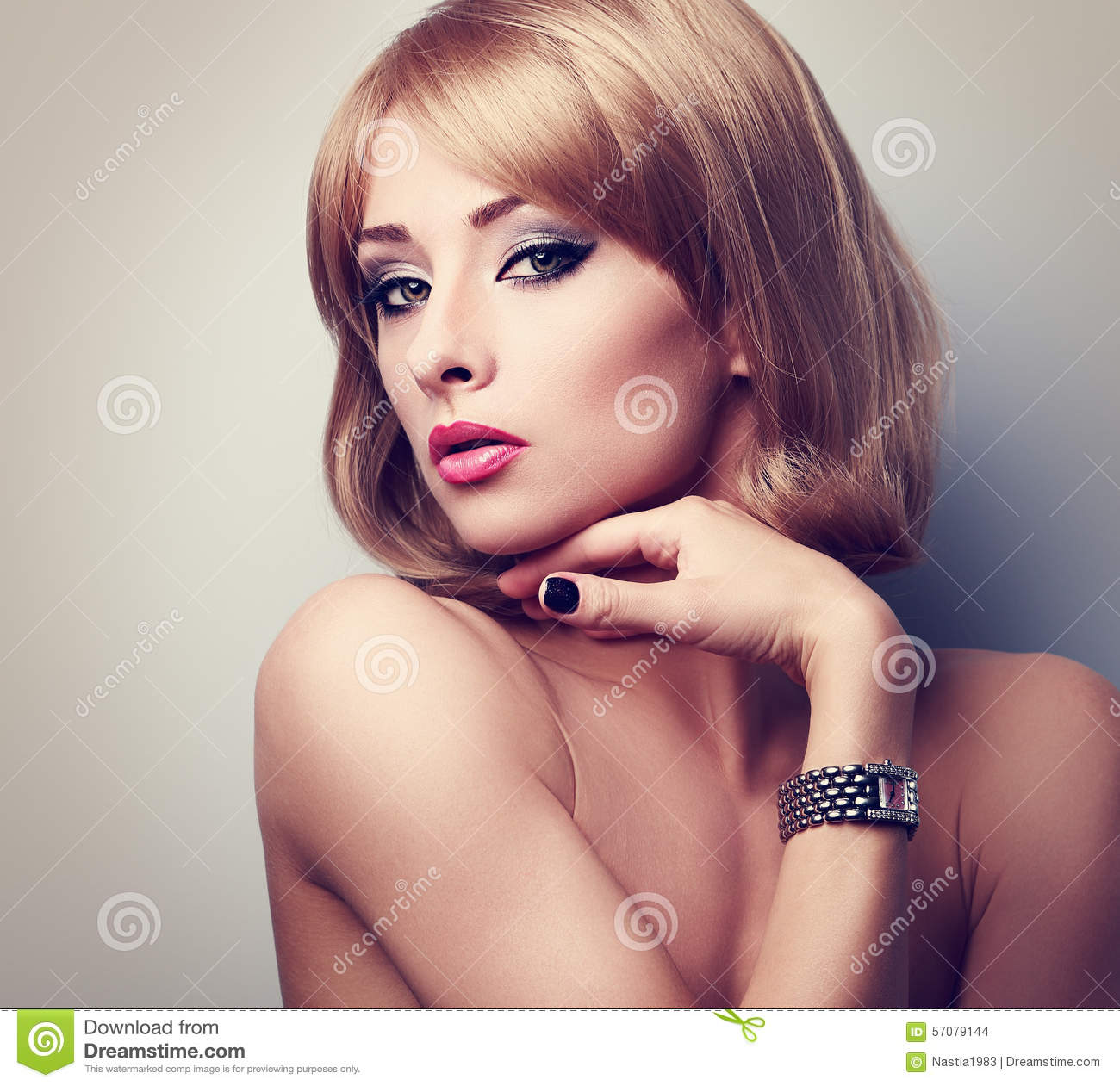 Beautiful Blonde Makeup Woman Posing In Fashion Watches On
