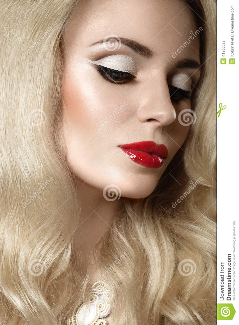 beautiful woman face with perfect make up and red lips ...