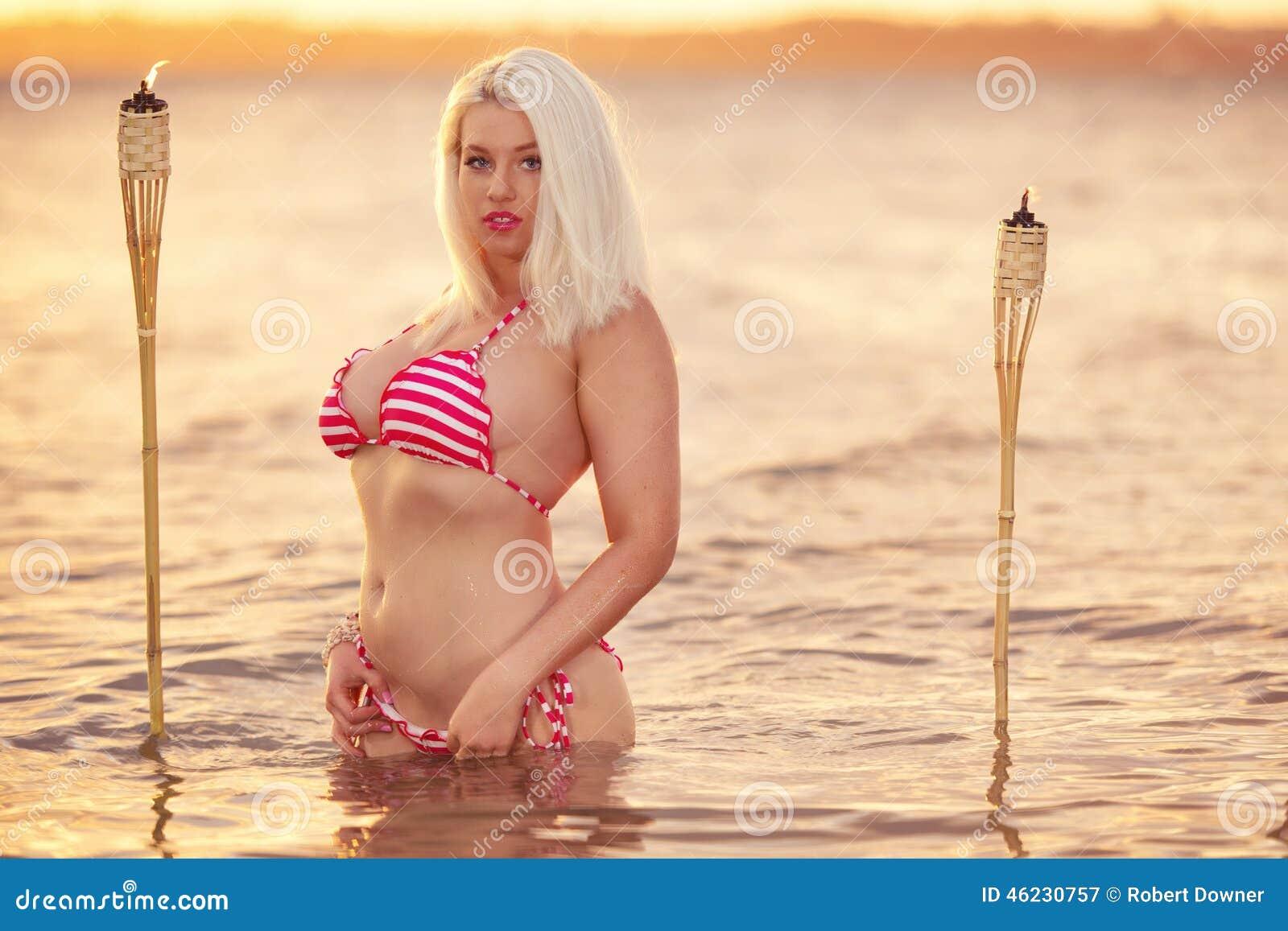 cdde833cf1 Beautiful blonde woman posing in a bikini on the beach at sunset in  Brisbane