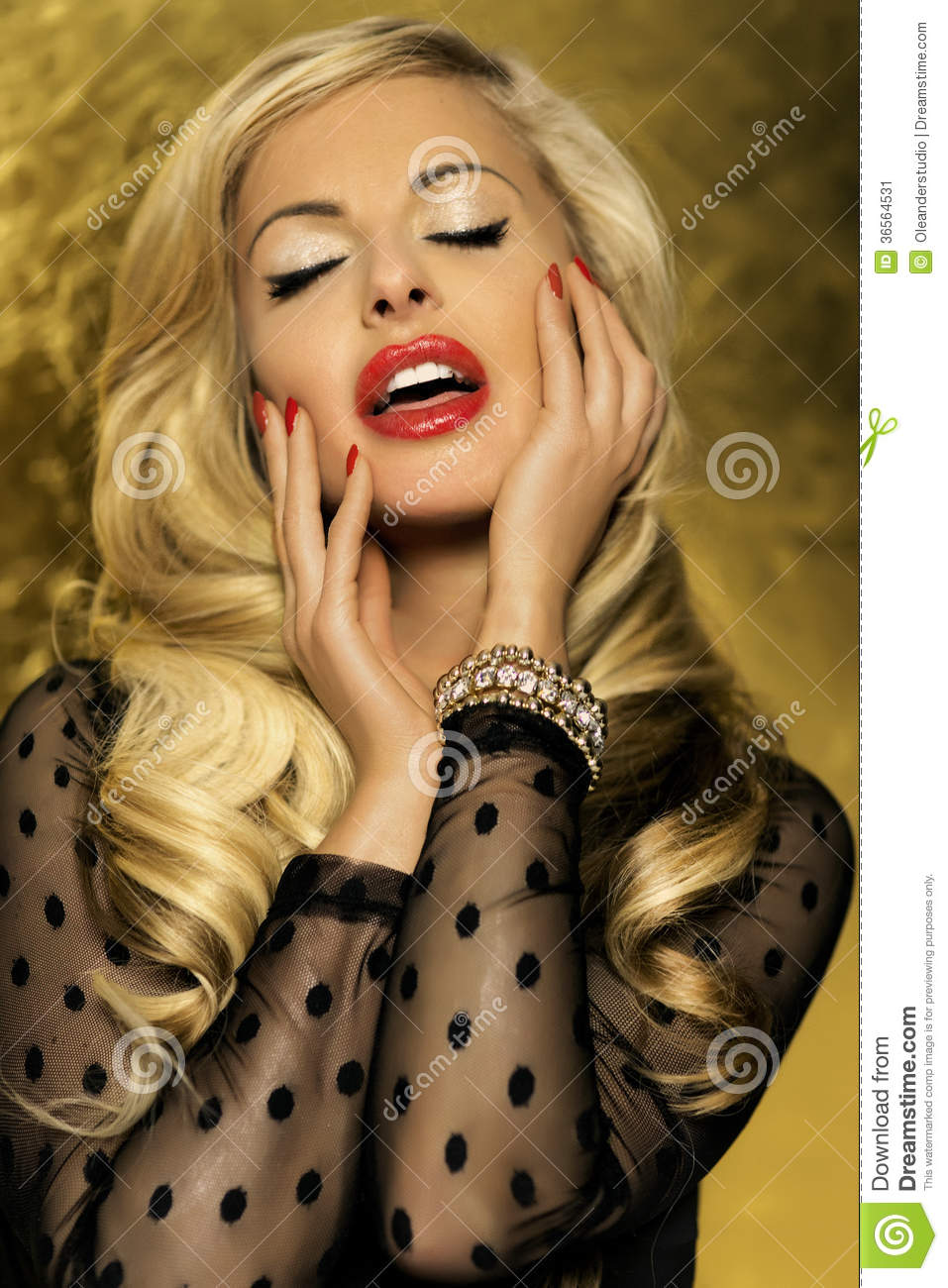 Beautiful blonde woman posing with closed eyes.