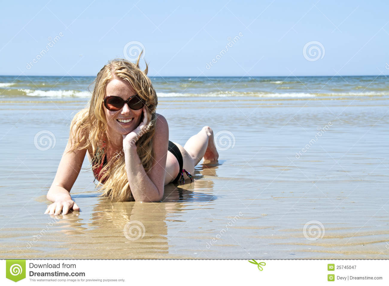Beautiful blonde woman relaxing at the waterfront