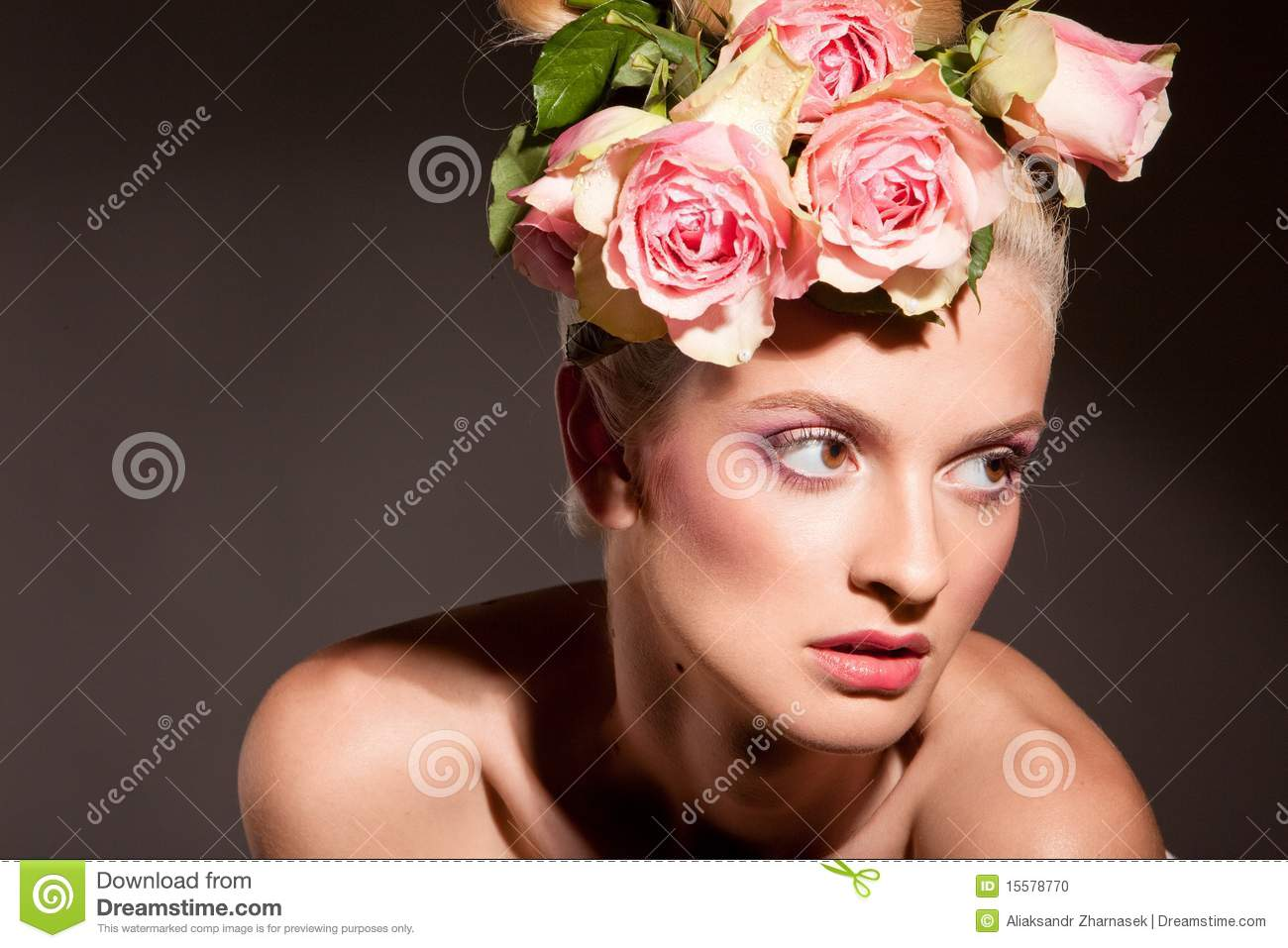 Beautiful blonde with a wreath of flowers