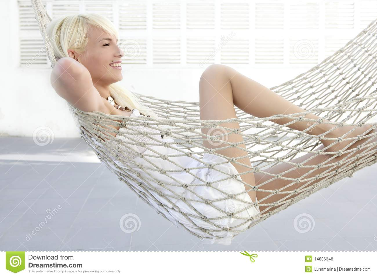 Beautiful blonde young girl relaxed on hammock