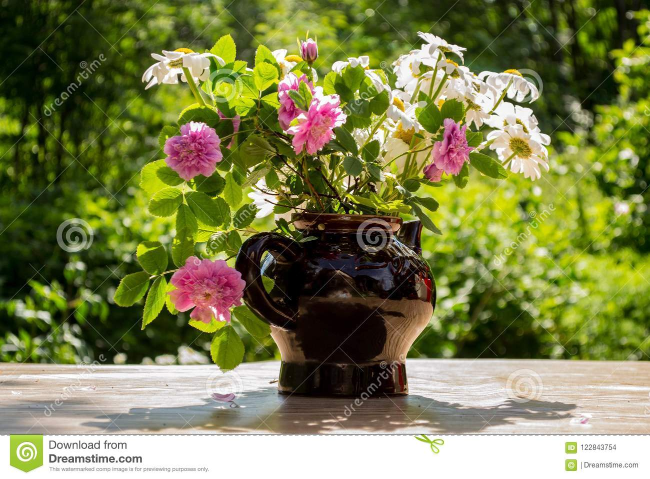 Beautiful Blooming Flowers In A Vase In The Gardern Stock Photo