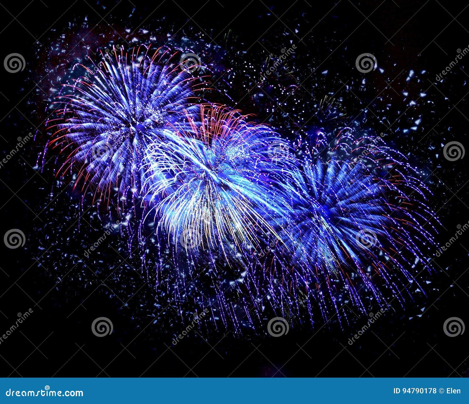 Beautiful blue fireworks in a night sky