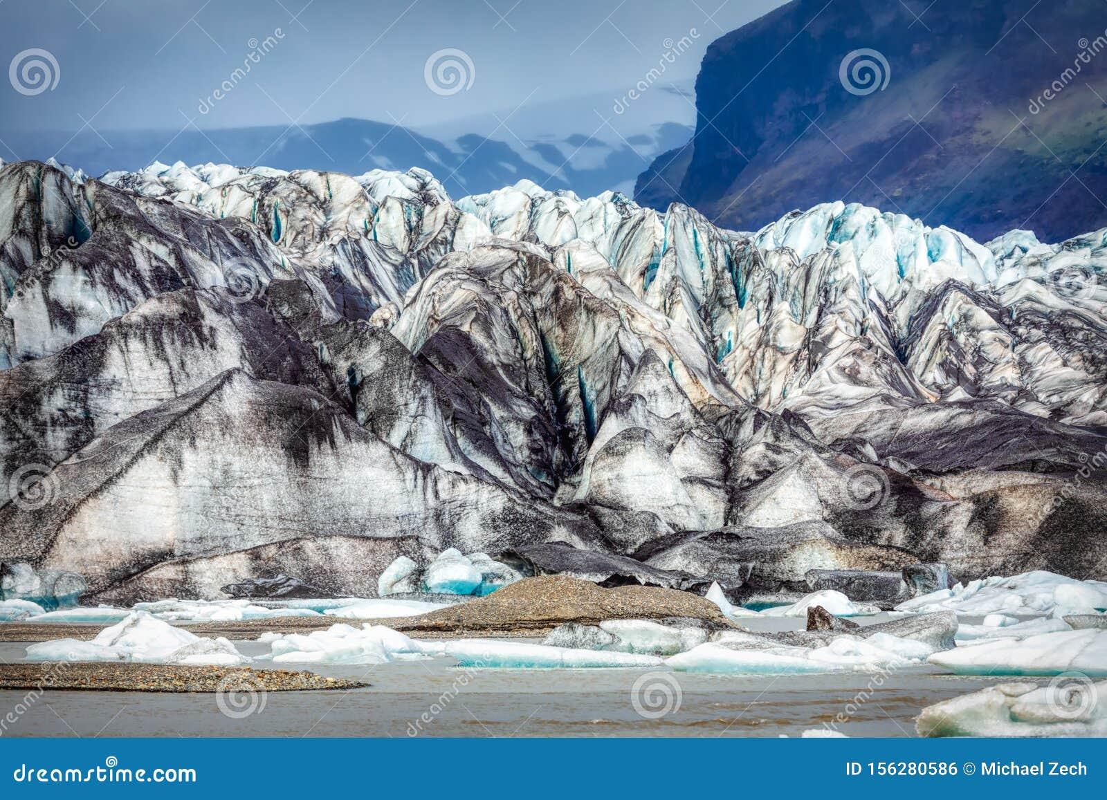 Beautiful blue shining glacier structure at the lagoon fjallsarlon on iceland