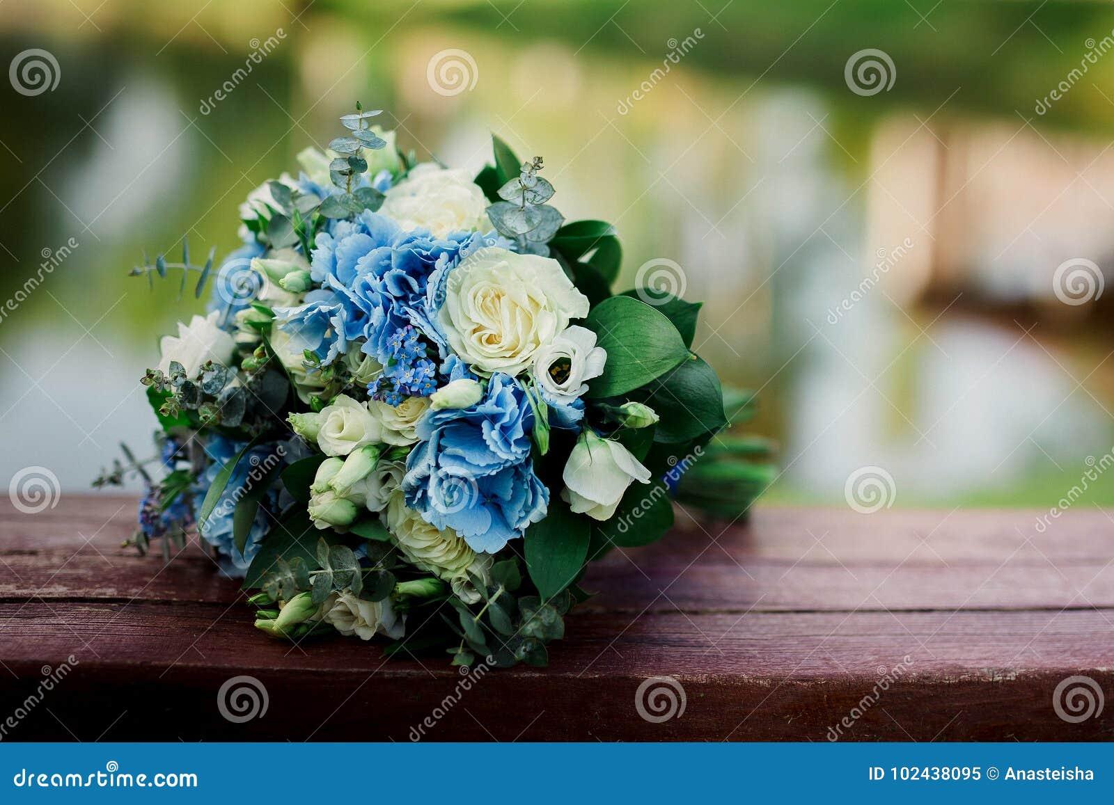 Beautiful Blue And White Fresh Flowers Wedding Bouquet Stock Image