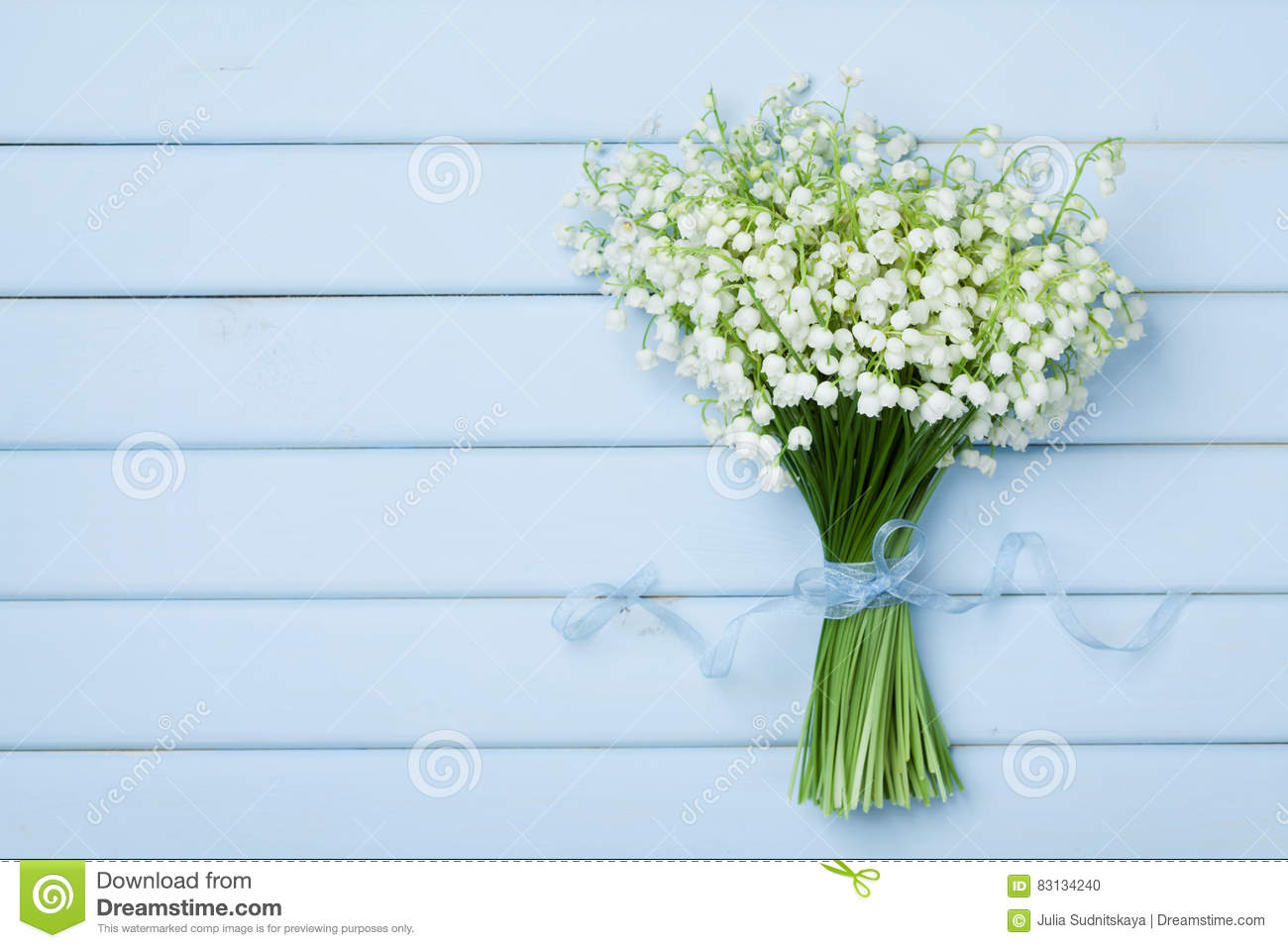 Beautiful bouquet of flowers lily of the valley on blue wooden table beautiful bouquet of flowers lily of the valley on blue wooden table from above izmirmasajfo