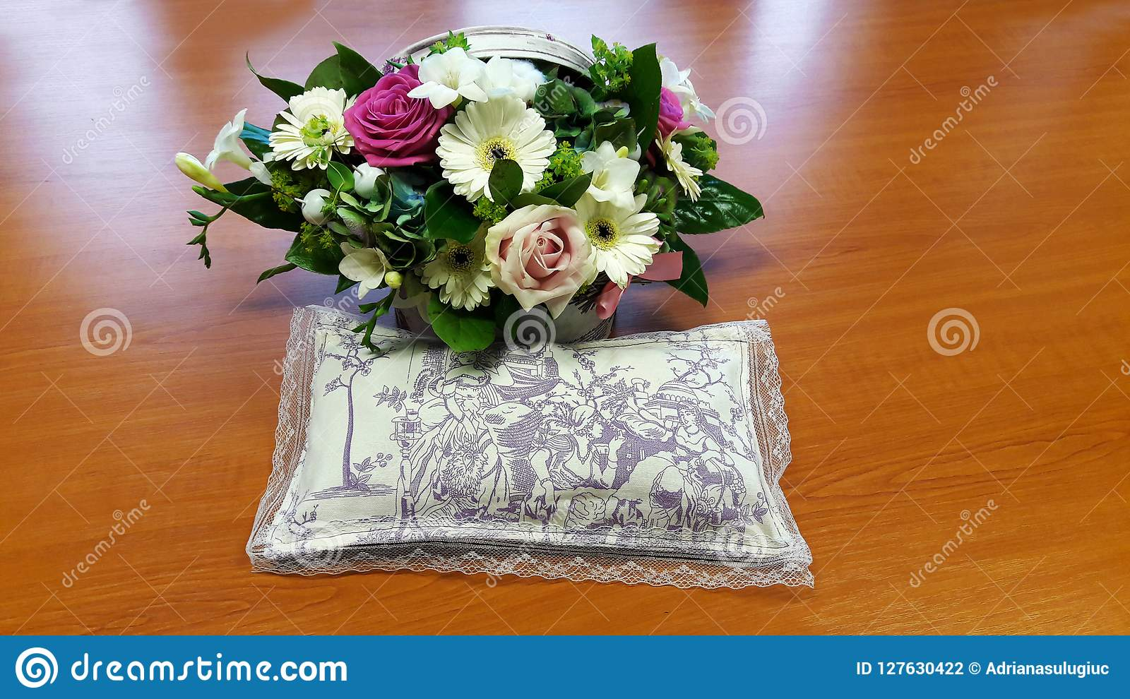 Beautiful bouquet of flowers and a pillow full of lavender