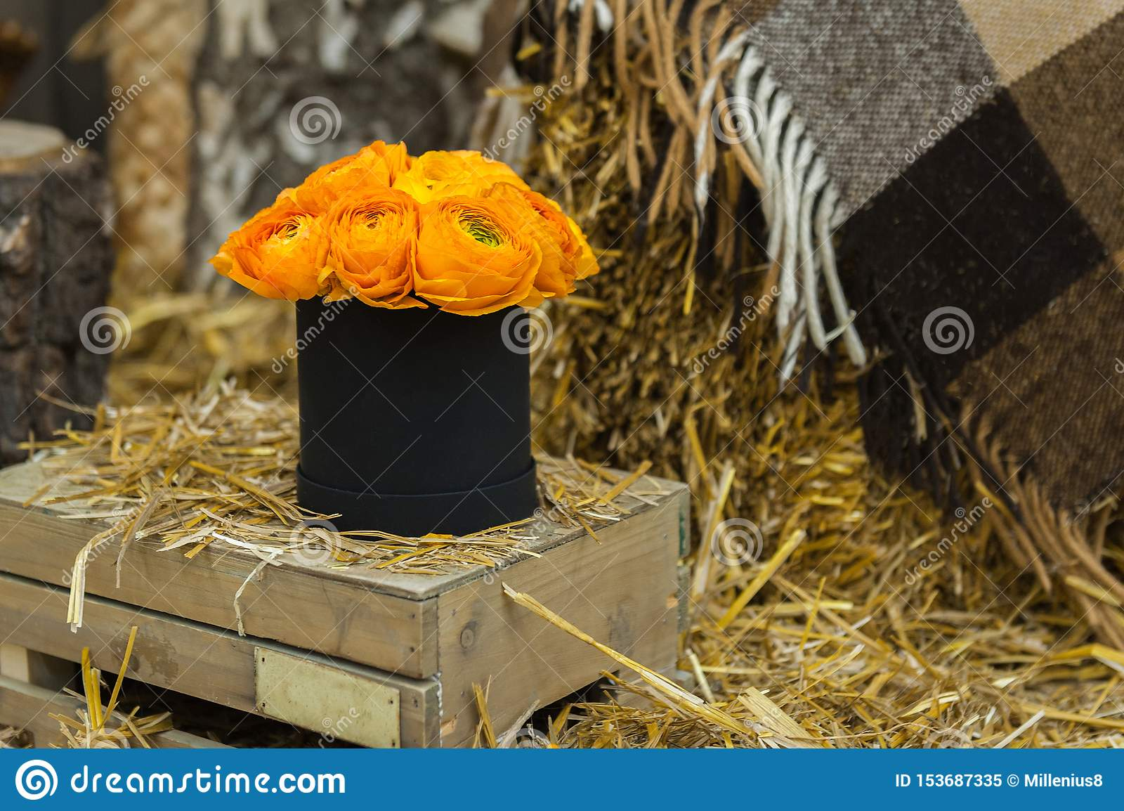 Beautiful Bouquet of flowers in a round hat box on a table