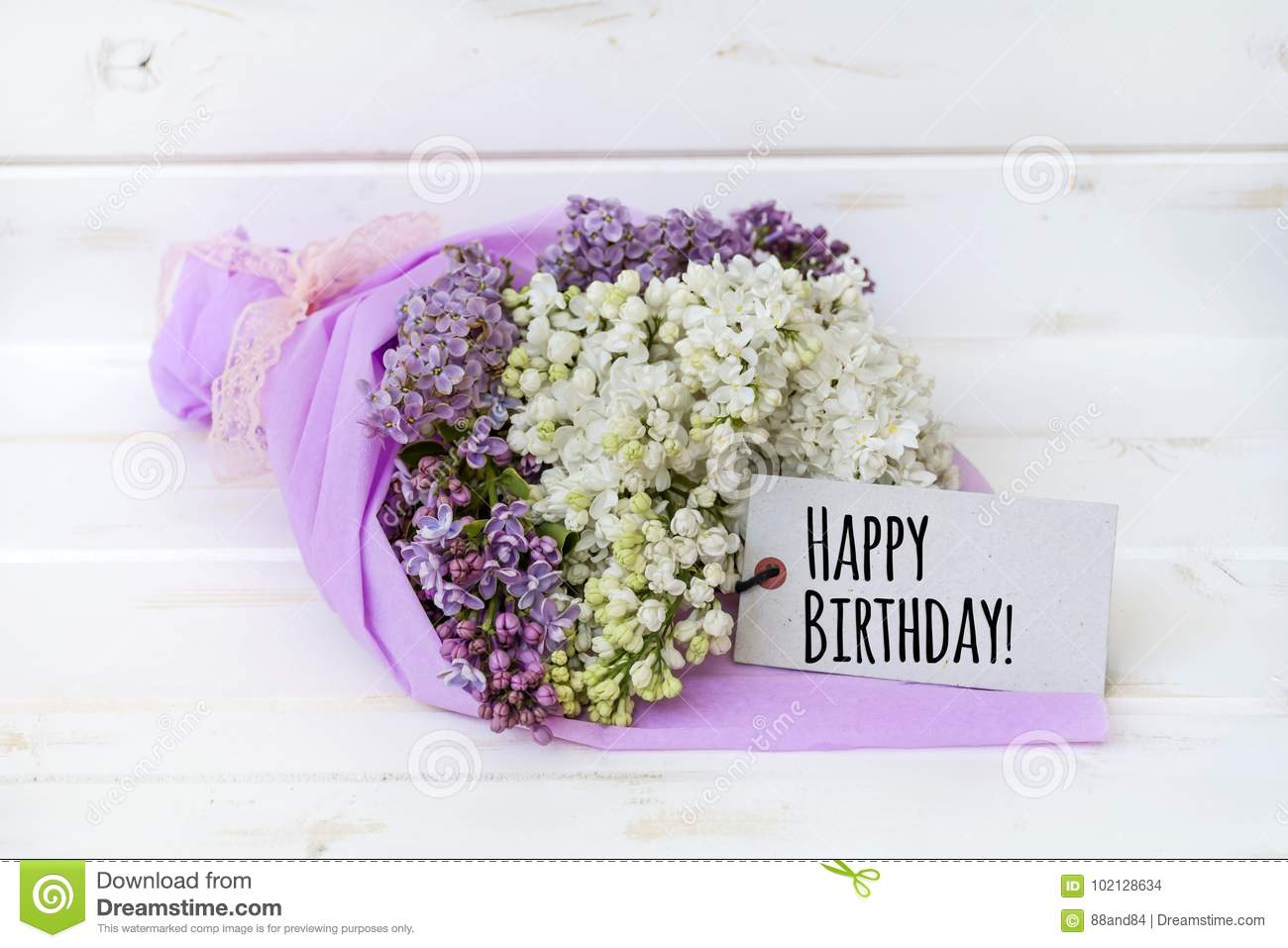 Beautiful bouquet of lilac with happy birthday card