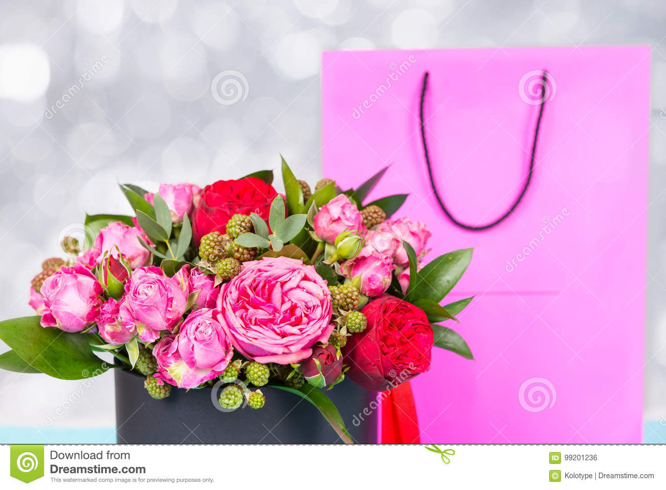 Beautiful bouquet of pink and red roses and red ribbon in a circ download beautiful bouquet of pink and red roses and red ribbon in a circ stock photo izmirmasajfo