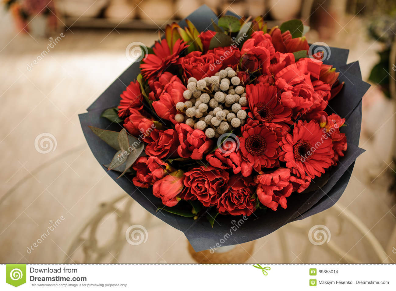 Beautiful Bouquet Of Red Flowers With Black Paper In Hands Stock