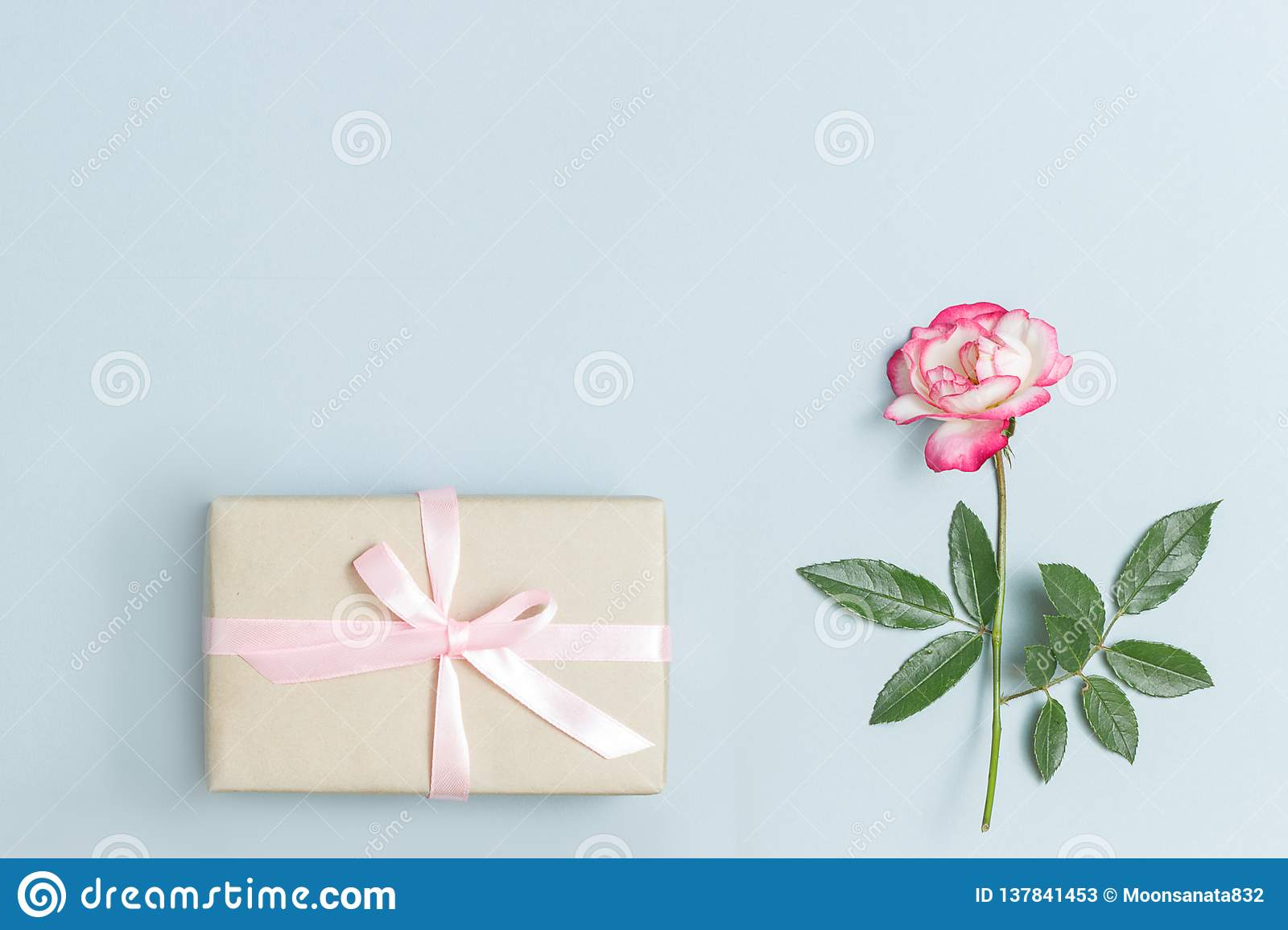 Beautiful Bouquet Of Small Red Roses In Vintage Paper On The Table