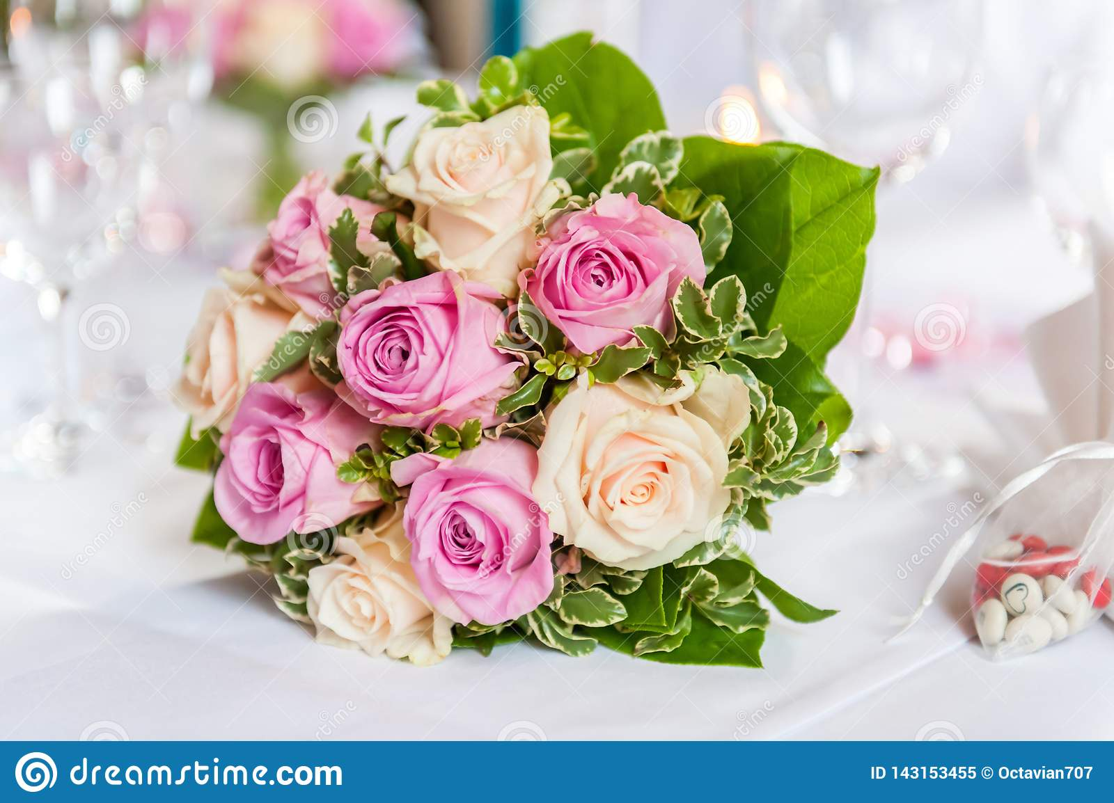 Beautiful Bouquet of yellow and pink Roses on decorated table