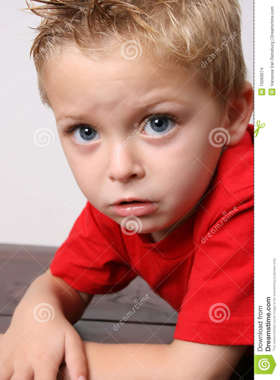 Beautiful blond toddler on a white background.