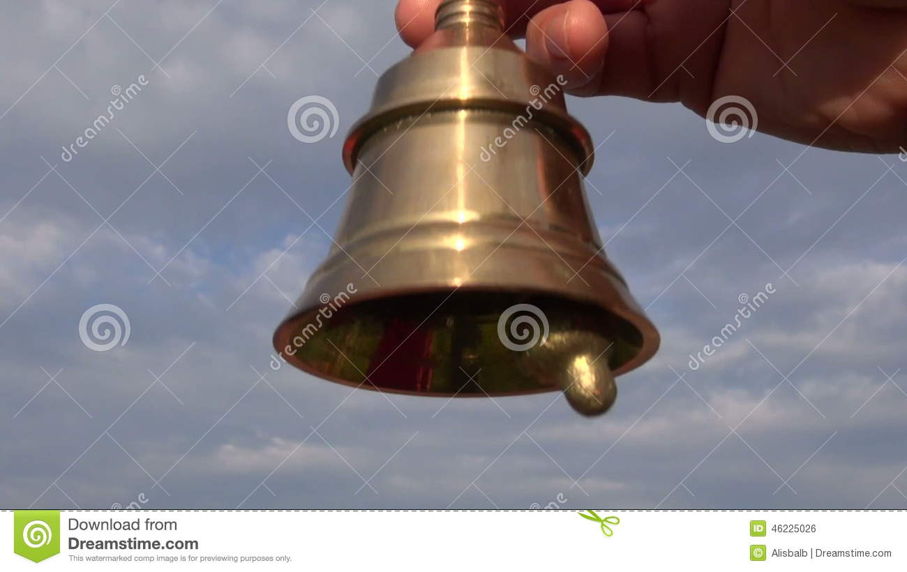 Beautiful Brass Bell Sound In And Sky Background Stock Footage
