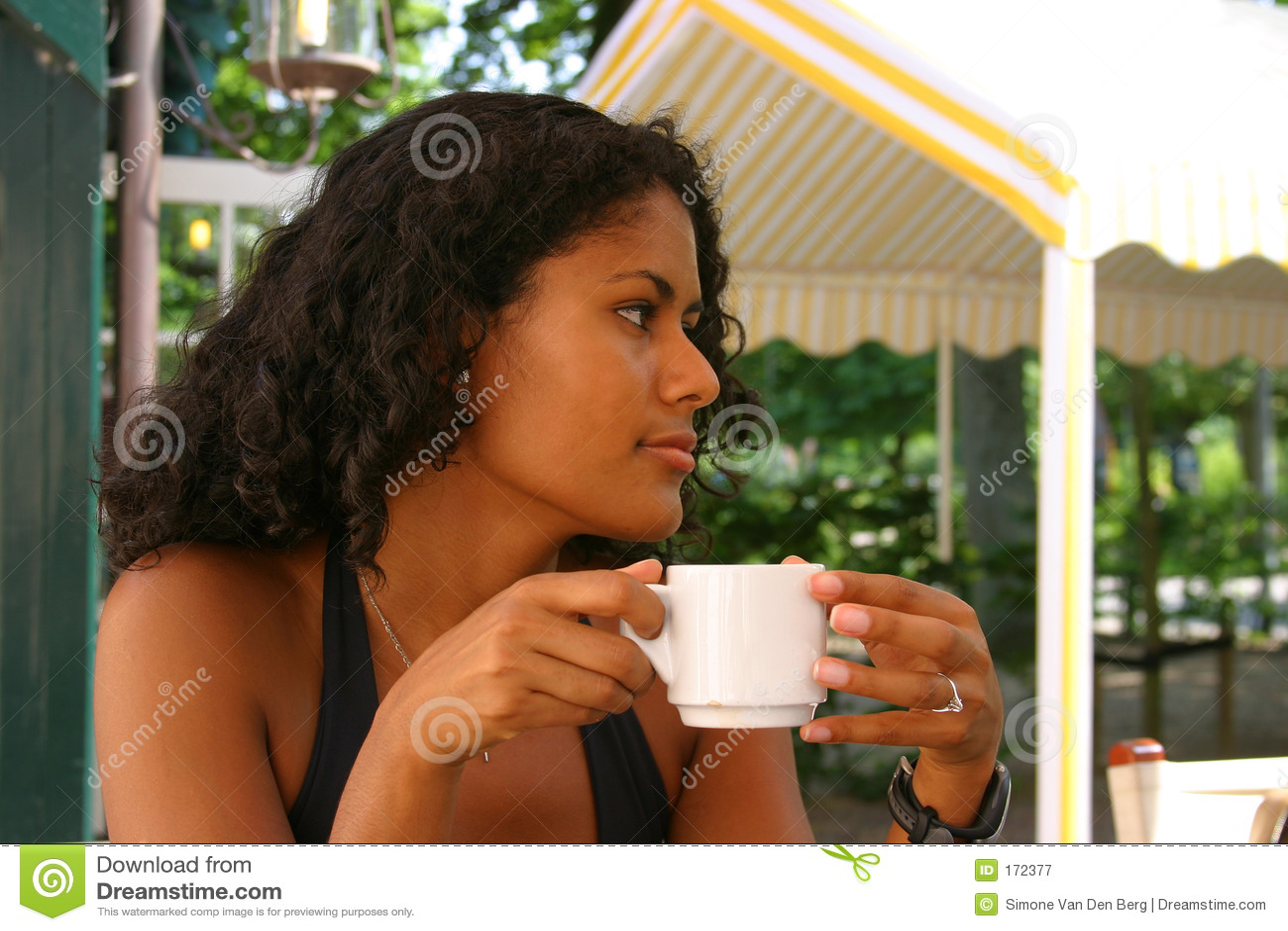 Beautiful brazilian woman drinking coffee