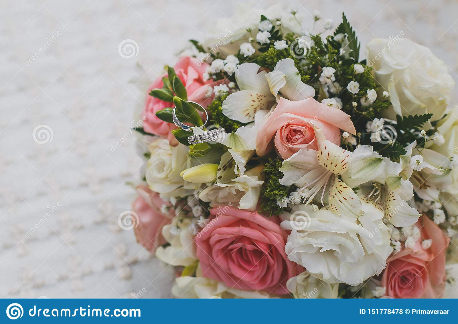 Beautiful Bridal Bouquet White Gold Wedding Rings On Flowers