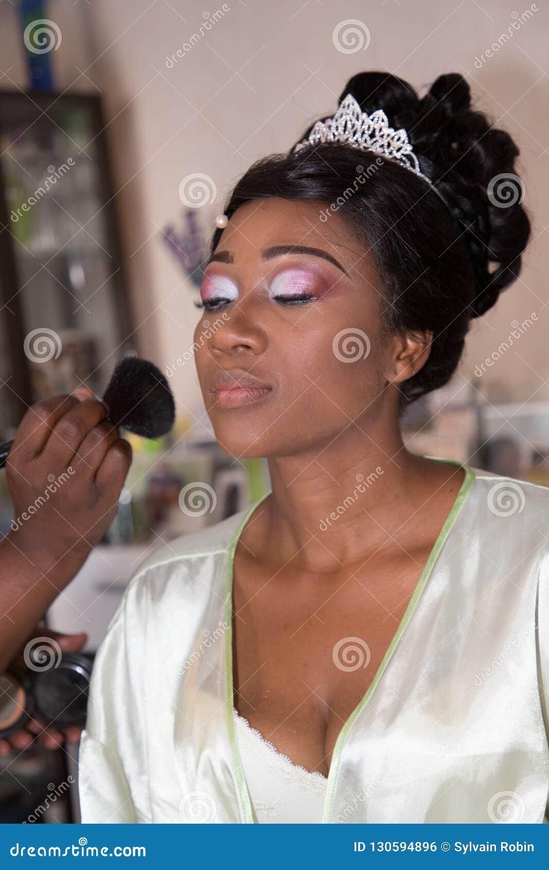 African American Wedding.Bride Applying Wedding Make Up For Black Skin African American