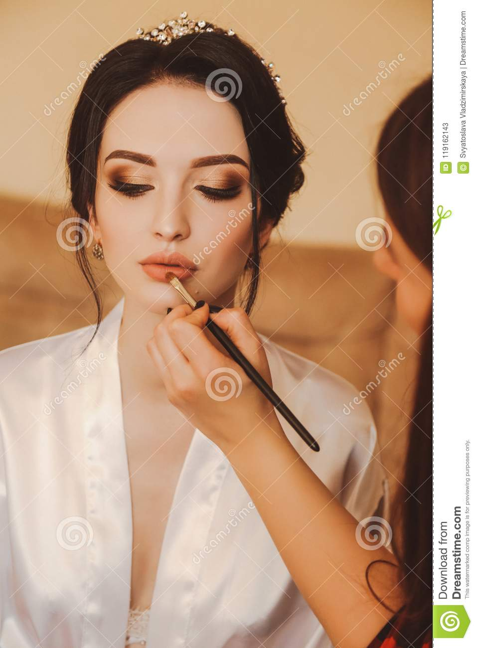 Beautiful Bride With Dark Hair Preparing Herself In Her