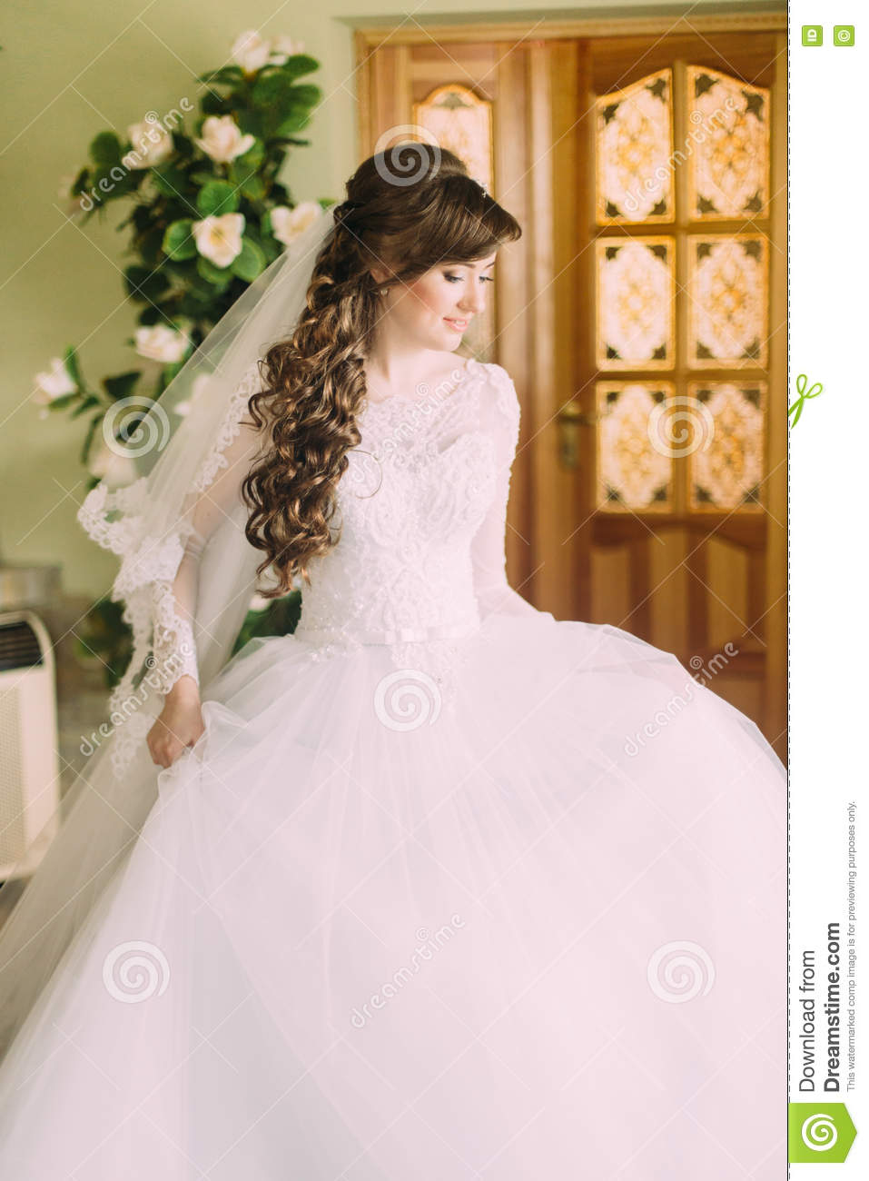 Beautiful Bride In Elegant White Wedding Dress And Veil With Long Curly Hair Posing Indoors Stock Image Image Of Hair Girl 70958207