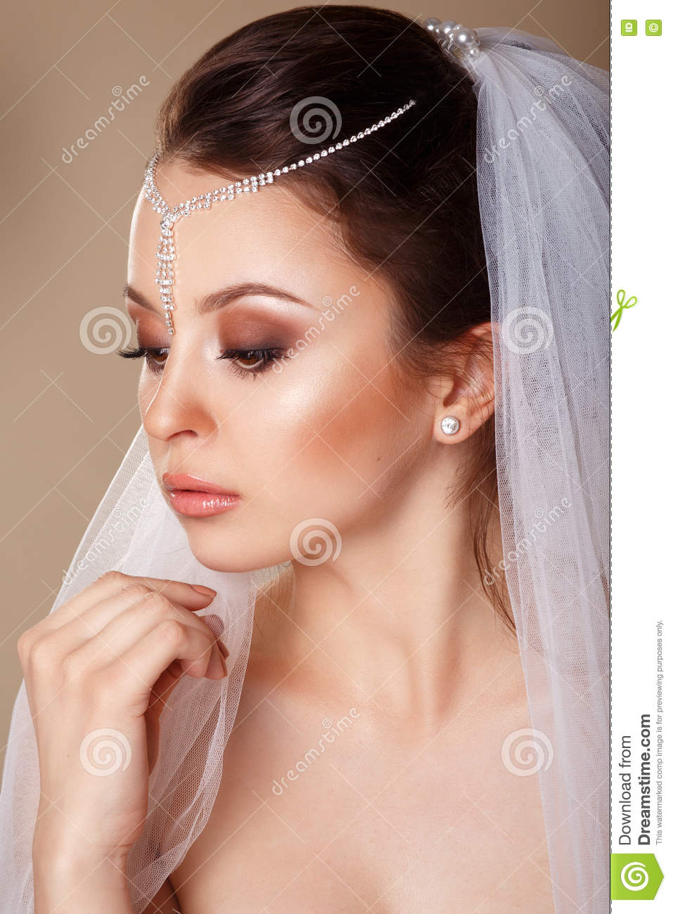 Beautiful Bride With Fashion Wedding Hairstyle With A Tiara In Her
