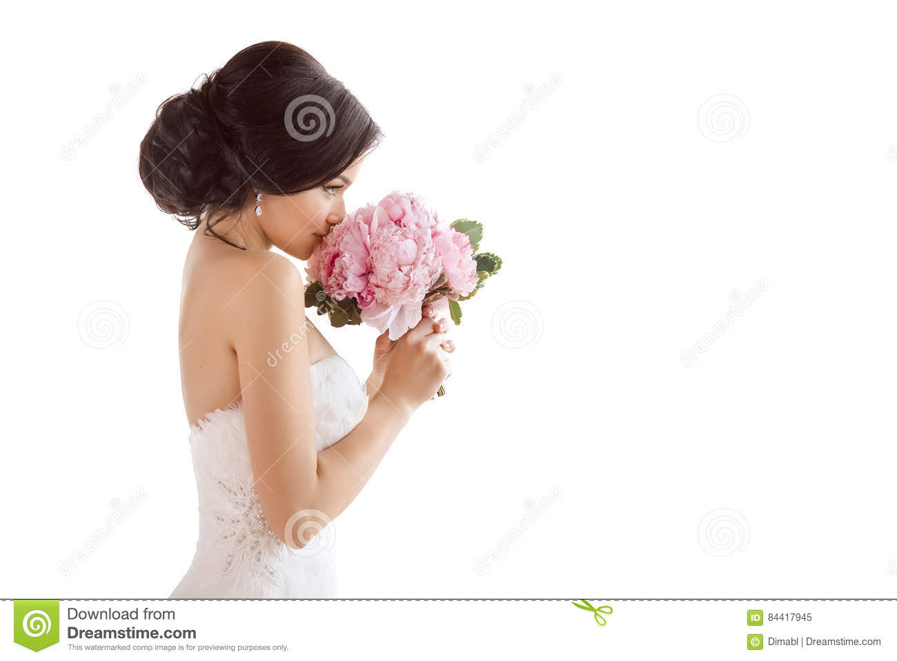 Beautiful bride with her flowers. Wedding hairstyle make-up luxury fashion dress and bouquet