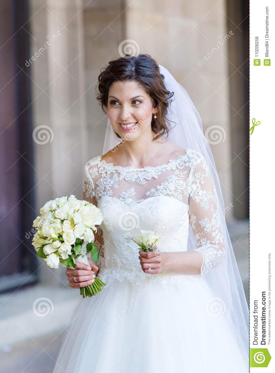 Beautiful Bride With Lace Dress And Bouquet From White Roses