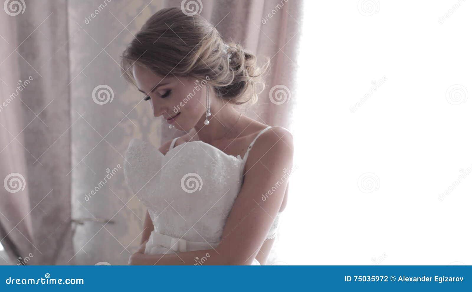 Beautiful Bride In Lingerie Tries On Wedding Dress Stock Footage ...