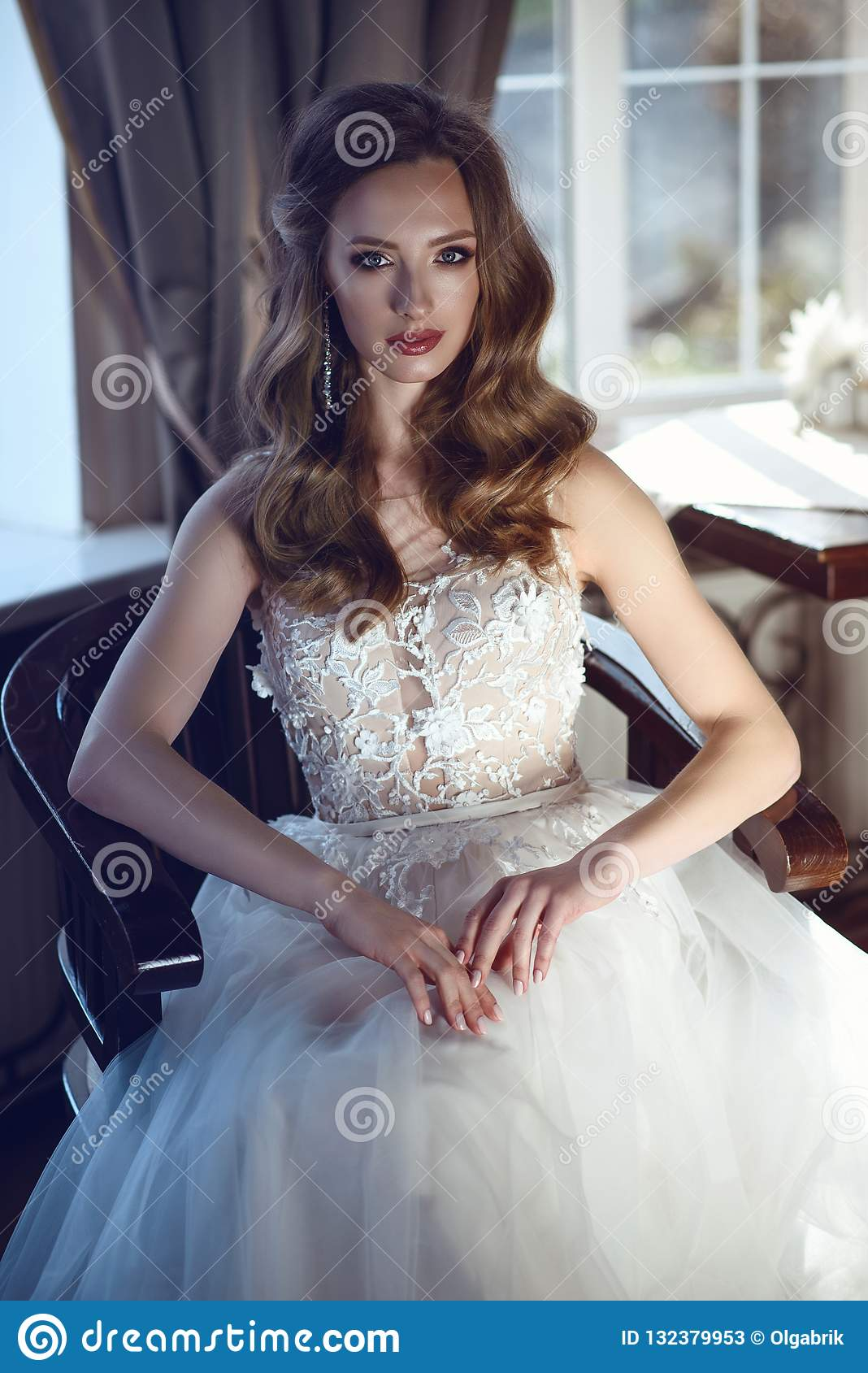 Beautiful Bride In Luxurious A Line Wedding Dress Sitting In The