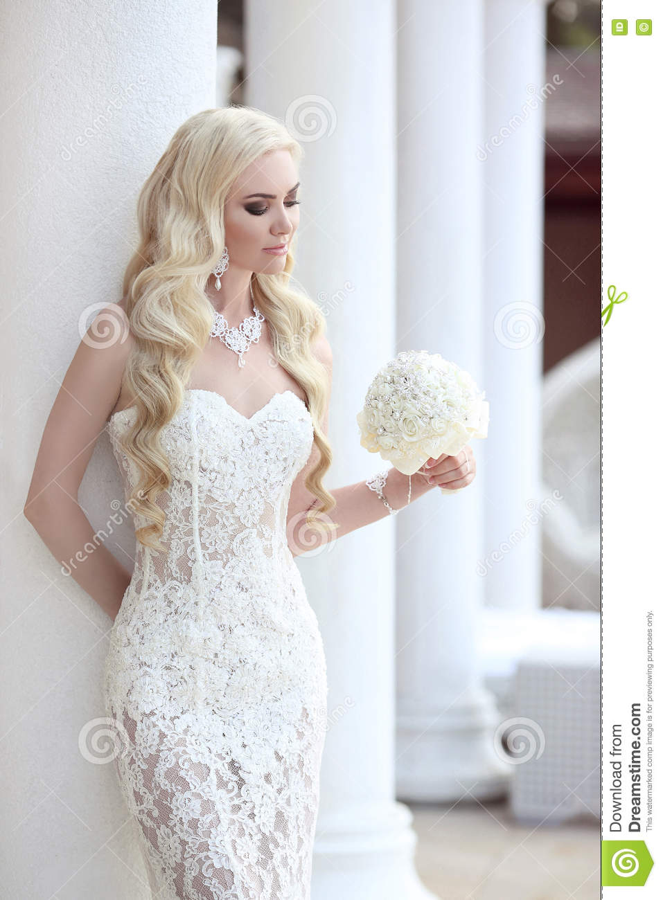 Beautiful Bride Portrait Holding Wedding Bouquet Posing In Lace