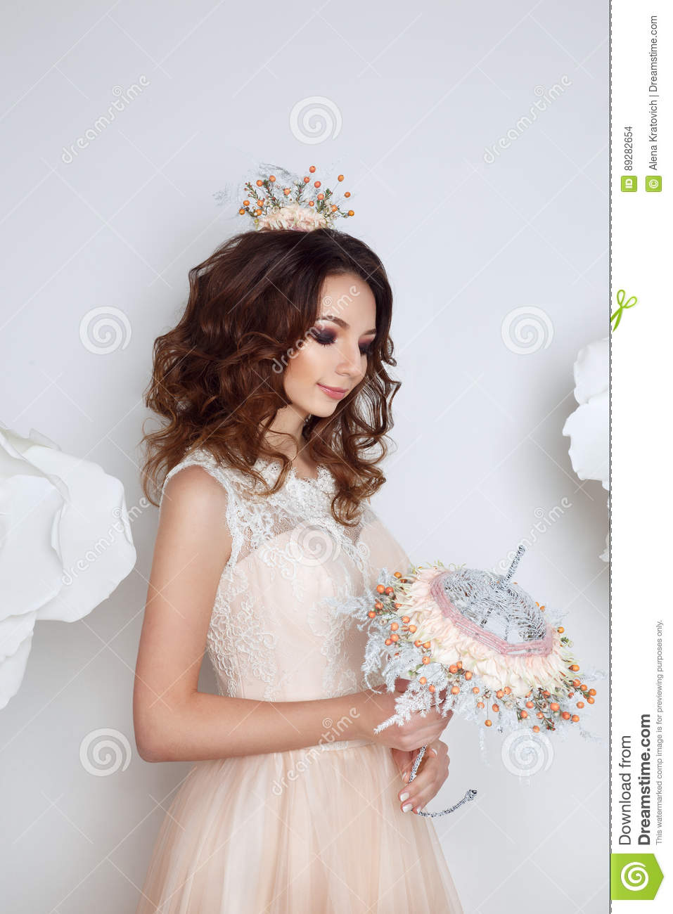 Beautiful bride posing in peach wedding dress and flower crown in a download beautiful bride posing in peach wedding dress and flower crown in a white photo studio izmirmasajfo