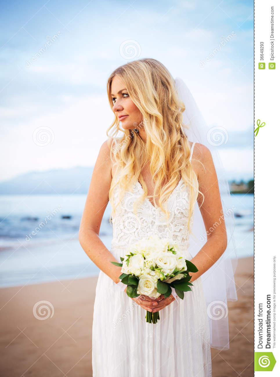 Beautiful Bride In Wedding Dress With Flowers At Sunset On Beaut ...