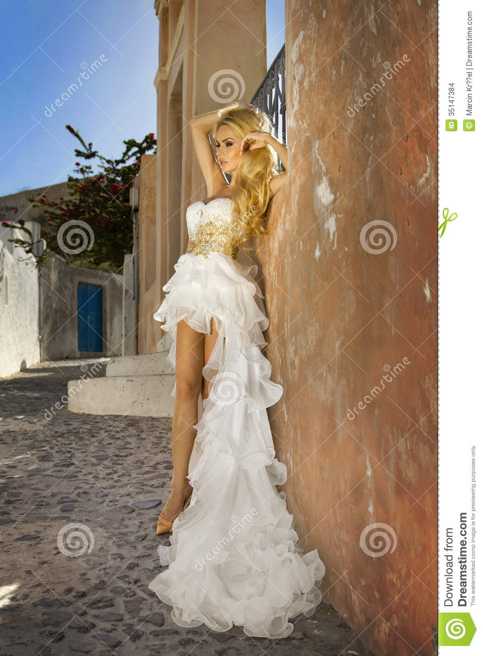 The beautiful bride in a wedding dress on santorini in for Very sexy wedding dresses