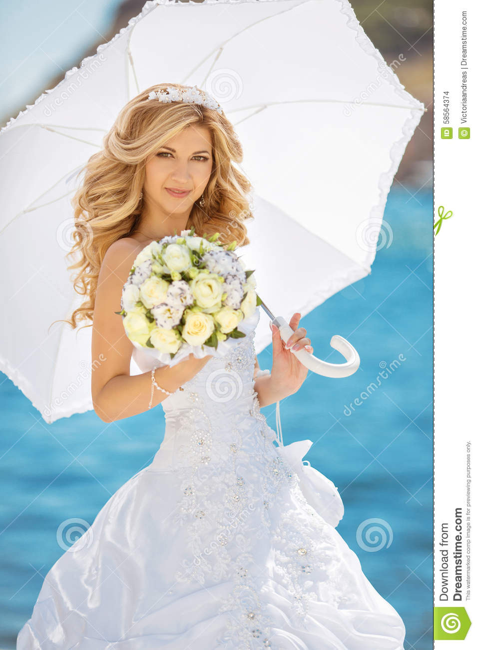 00fb3f5056 Beautiful bride in wedding dress with white umbrella and bouquet of flowers