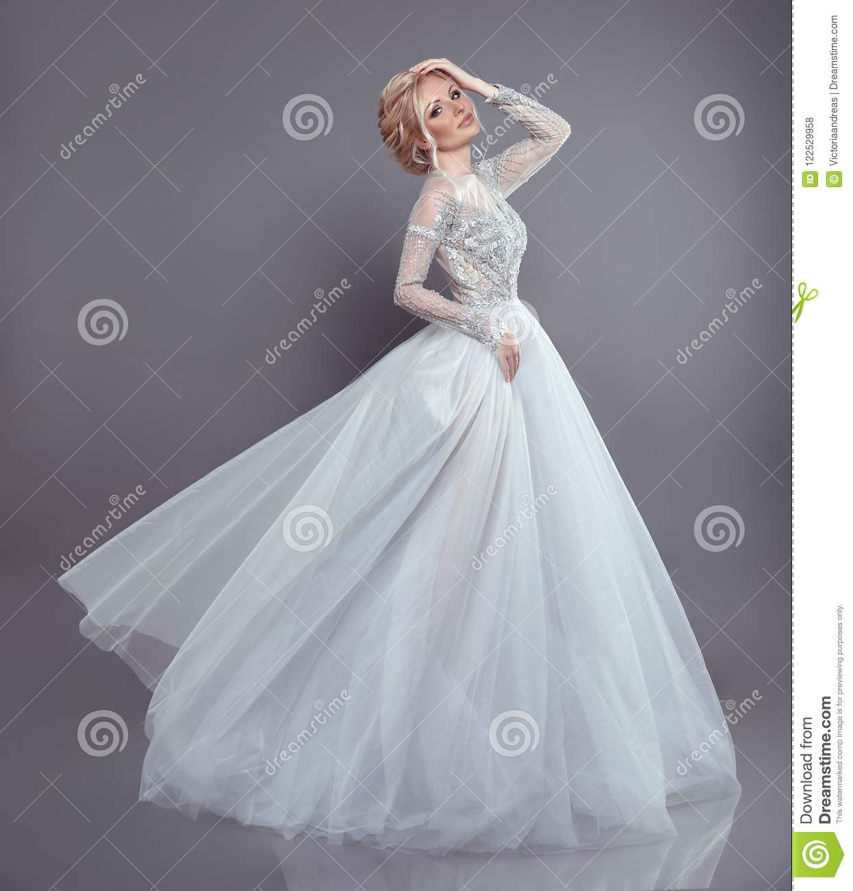 Beautiful bride in wedding flowing chiffon dress, Woman in long